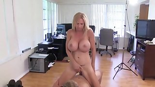 Sporty MILF with big boobs makes love with young guy