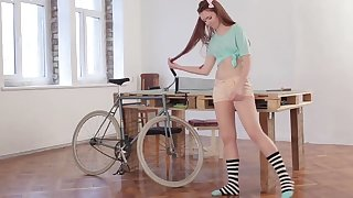 young teen with her bike